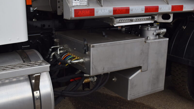 hydraulic tank installed on snow and ice truck upfit